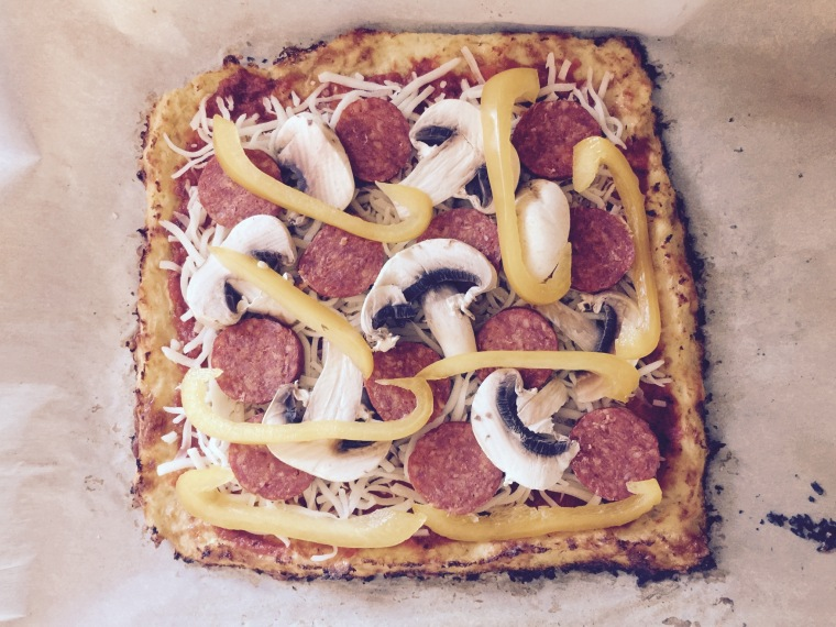 Top with your cheese and toppings. Put back into your 400 degree oven for 5 or so minutes or until pizza cheese is bubbling.