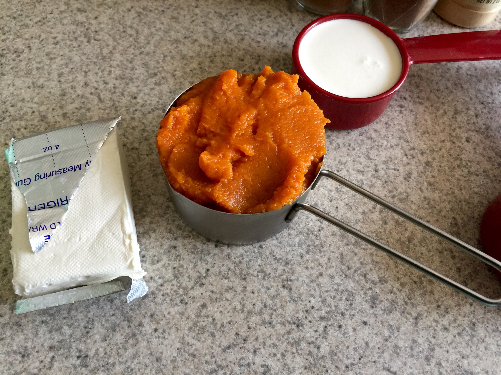 Measure out ingredients. 1/2 cup pumpkin, 1-2 tbsp's sweetener of choice, 3 tbsp of cream cheese, 1/4 cup of heavy cream. Add to blender. Add 1 cup or so of ice. Add spices. I just do a few shakes of each. Blend in blender. Mixture will be thick because of the whipping cream. Keep adding ice until you get your desired texture.