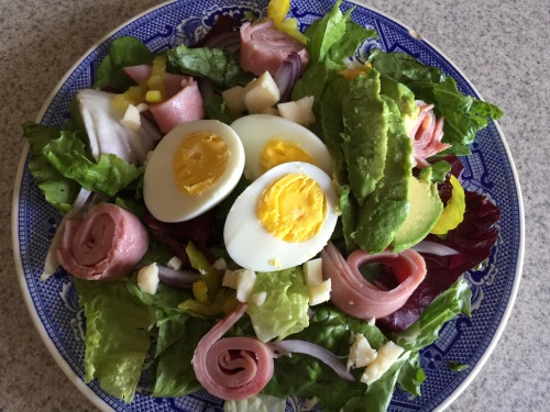 Lunch- Club salad with greens, avocado, egg, ham, peppers, onions, and white cheddar.