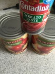 What you need- 2 large cans of whole peeled tomatoes. Or crushed. If you have whole, you have to process them.
